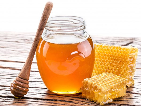 Honeycomb and pot of fresh honey. High-quality picture contains clipping paths.